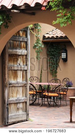 A Glimpse Through an Archway into an Inviting Spanish Courtyard