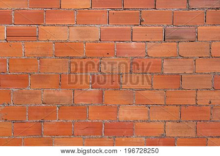 Unpainted brick wall. Background texture.