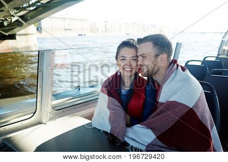 Affectionate dates enjoying voyage on sunny day