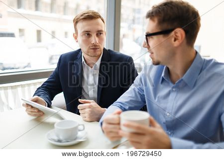 Appointment and talk of brokers in cafe