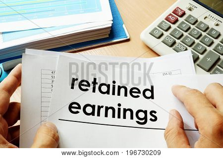Papers with title retained earnings. Business concept.