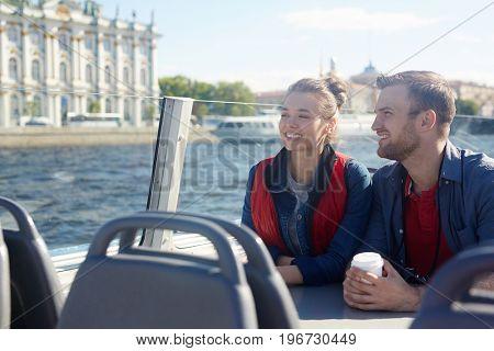 Urban lovers on motor-boat enjoying their honeymoon
