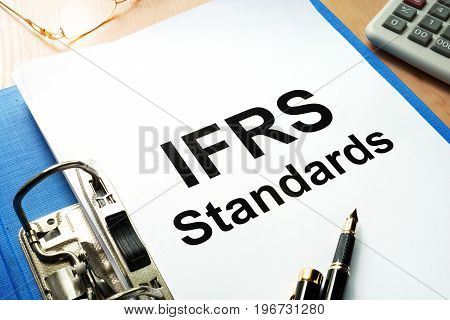 A Folder with documents IFRS standards. Business concept.
