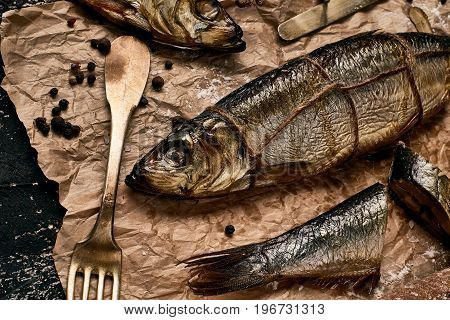 Dinner with seafood without delicacy. The fish prepared on a smoke.