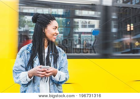Black Girl Typing On Smartphone In Berlin