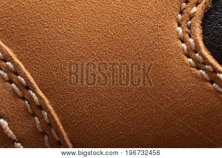 leather boots stitched with thread