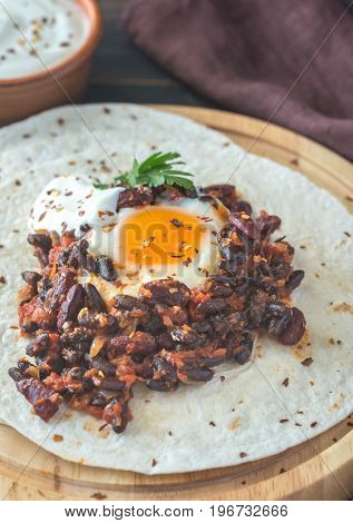 Tortilla With Chipotle Bean Chili And Baked Egg