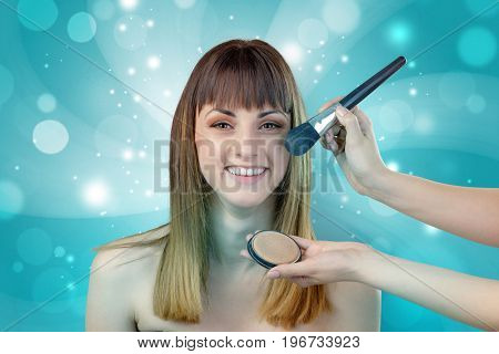 Graceful brunette woman getting ready with shiny turquoise wallpaper