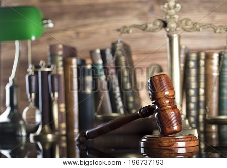 Business and law theme. Gavel and different codes of economic activity.