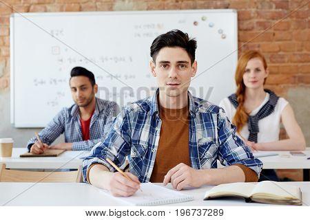Guy preparing for lesson or seminar