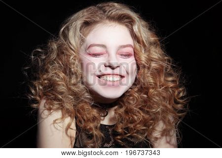 Portrait of young girl bursts out laughing