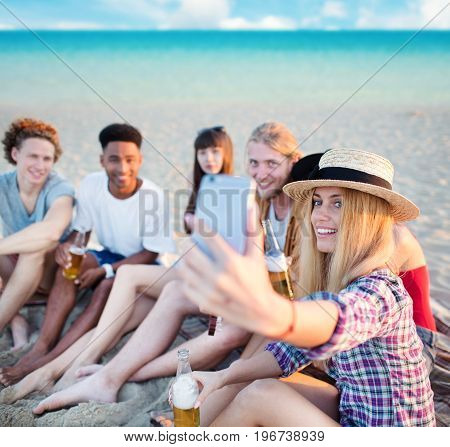 Happy group of friend makes a selfie with a mobile phone for social network
