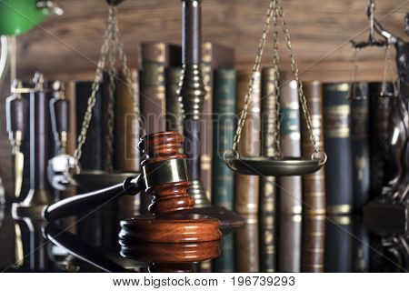 Court library. Gavel, scale of justice and books.