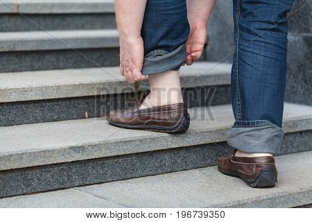 Walking Upstairs: Close-up View Of Man's Leather Shoes