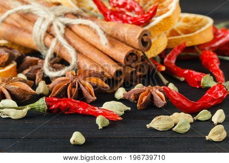 Autumn Composition With Different Dried Fruit And Vegetable: Lemon, Orange, Cayenne And Cinnamon