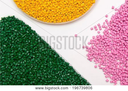 The plastic granules. Dye for polypropylene polystyrene granules into a measuring container