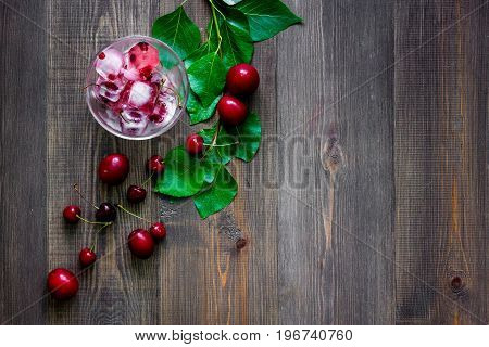 Fruits and berries for summer fruit drink on wooden table background top view.