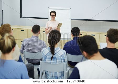 Teacher discussing new business project with students