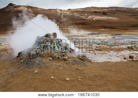 Boiling mud pool in the hverastrond sulphur springs near lake myvatn, north iceland