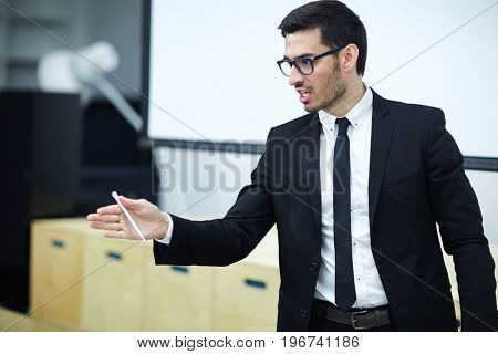 Ambitious businessman voicing his opinion or commenting someone else's