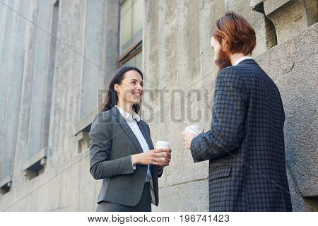 Two young entrepreneurs talking about joint venture