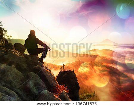Film Effect.hiker Man Take A Rest On Mountain Peak. Man Lay On Summit, Bellow Autumn Valley. Bright