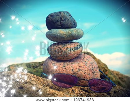 Film Effect. Pink Summer Glasses And Stone Pyramid On Sea Shore, Waves In Background.