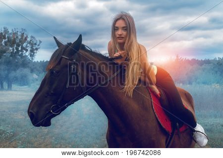 beautiful young lady posing on horseback close-up