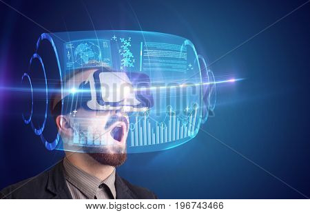 Amazed businessman with high tech 3D projection in front of him