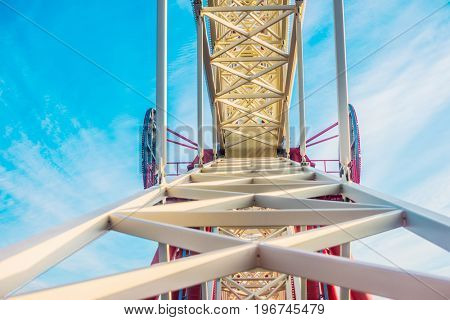 ferry wheel in park against blue sky