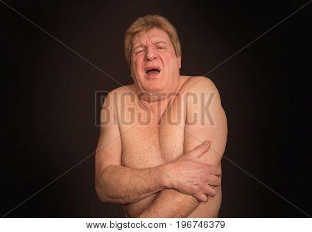 Senior man with osteoarthritis pain at studio