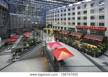 Paris France May 29 2017 : Interior of a beautiful and modern mall with restaurant and terrace office district Italy place in Paris france