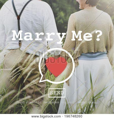 Marry Me heart symbol on senior lovers