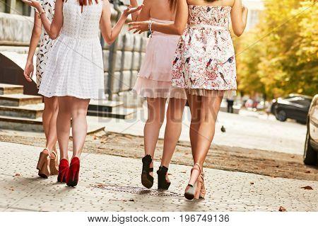 photo of group beautiful woman walking outdoors