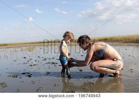 Mother And Son In Healing Mud