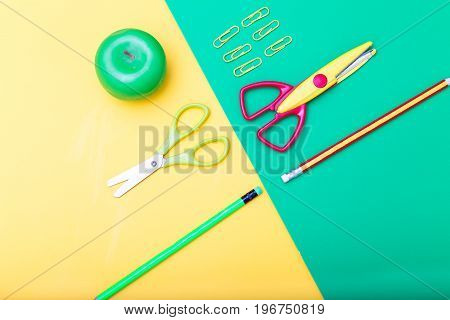 School supplies on Yellow-green background. isometric style