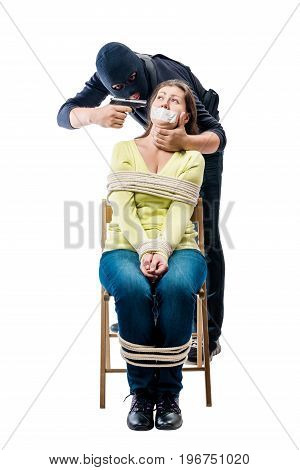 Cruel Criminal In A Balaclava With Arms And Girl Hostage On A White Background