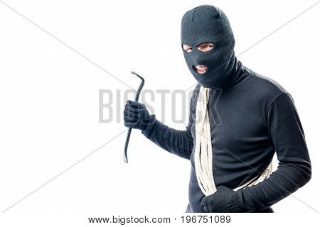 The Robber With A Rope And A Crowbar Went To Rob The House