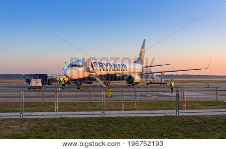 MODLIN, POLAND - APRIL 2, 2017: Preparing for boarding to Ryanair plane in Warsaw Modlin airport in Poland. Ryanair operates over 300 aircraft and is the biggest low-cost airline company in Europe.