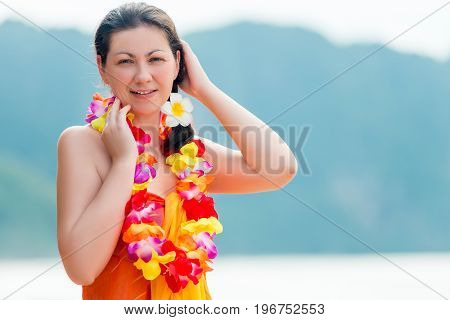 Beautiful Brunette With Beads Traditional Floral Hawaiian Lei On The Beach