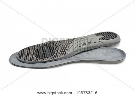a pair of latex shoe insoles isolated on a white background