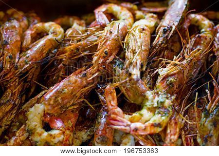 Royal Prawns, Seafood On The Grill On The Stove, On The Street Food Market. Shrimp As Background.