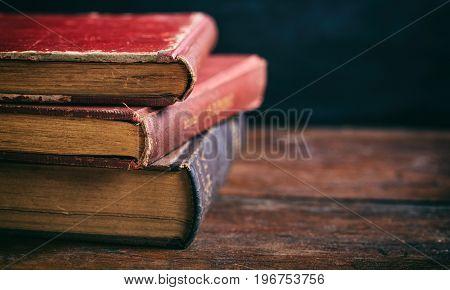 Vintage Books Stack On Dark Background