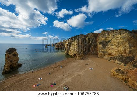Lagos Portugal - July 6 2017: People at the beach in Dona Ana Beach (Praia de Dona Ana) in Lagos Portugal