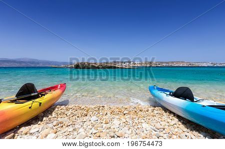 Canoes lying on a pebble beach in the Cyclades of Greece, Aegean Sea