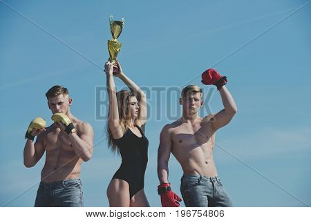 Winner And Loser In Boxing Gloves With Girl.