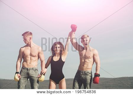 Woman And Happy Twins With Muscular Body.