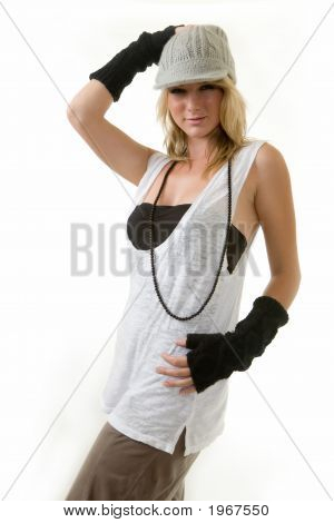 Cute blond hair young woman wearing funky hat and arm covering for a funky style standing on white poster