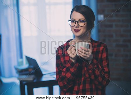 Businesswoman At Home Interior With Cup Of Coffee.