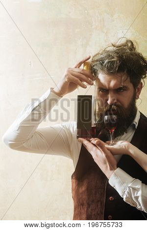 Hipster With Bottle Of Wine And Glass On Female Hands